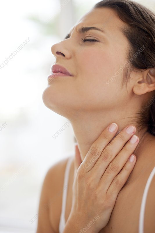 Woman with hand on throat in pain