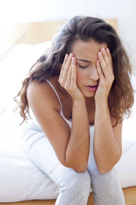 Woman on bed in pain