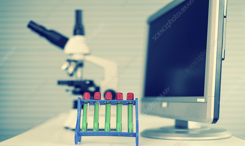 Test tubes and computer