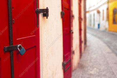 Red door and padlock