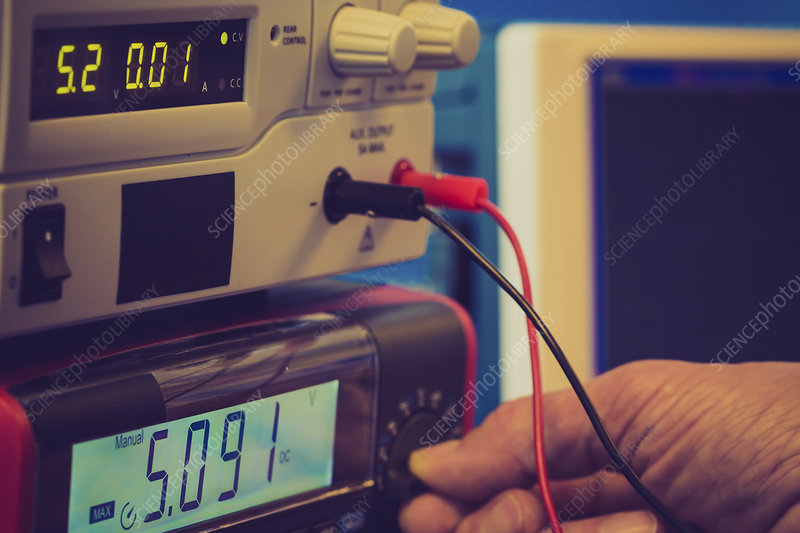 Person using control panel in lab