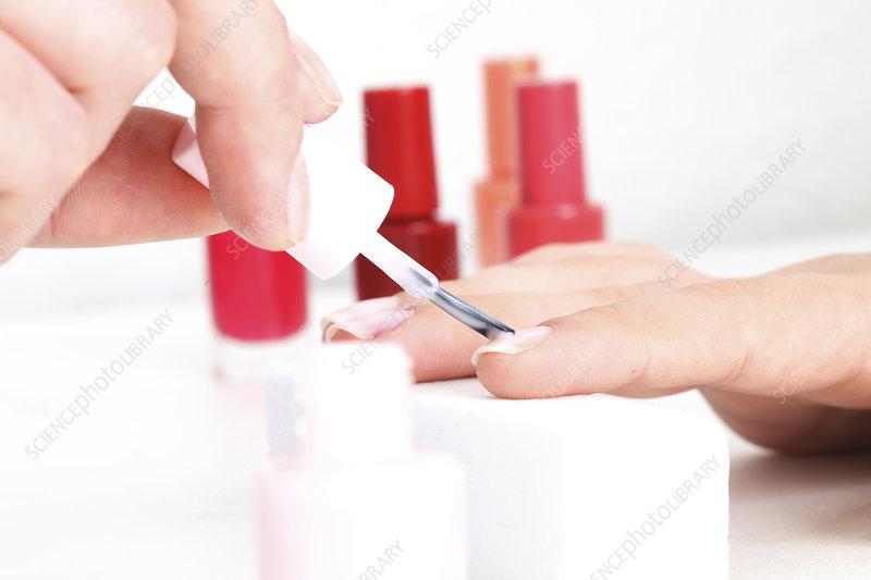 Person having fingernails painted