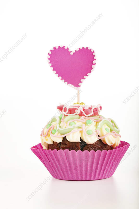 Cup cake with heart decoration