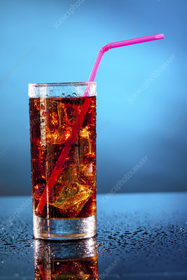 Glass of soda with a drinking straw