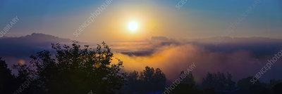 Misty scene at sunset