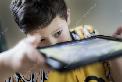Young boy playing on handheld device