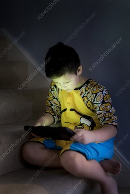 Young using handheld device