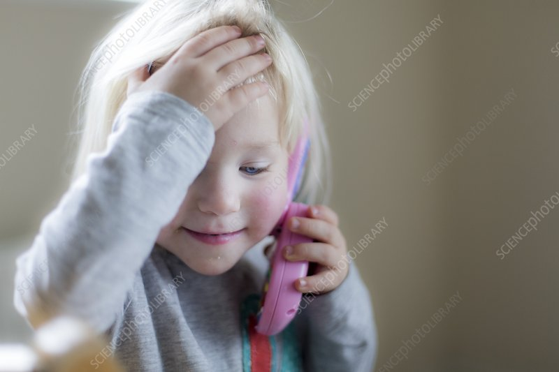 Toddler playing with toy phone