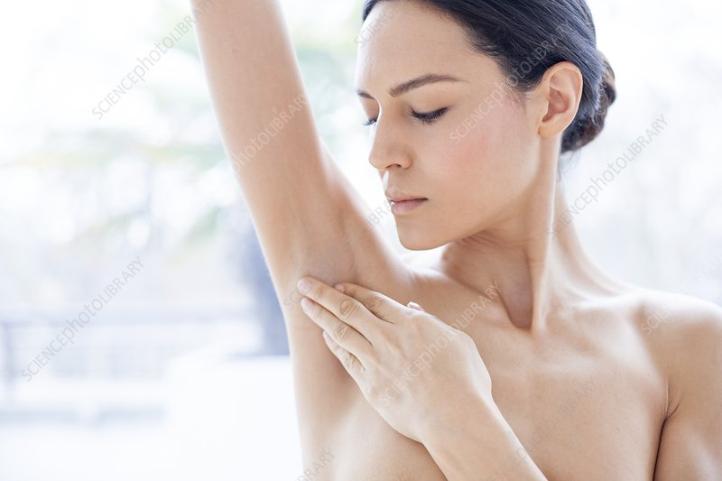 Woman touching her underarm