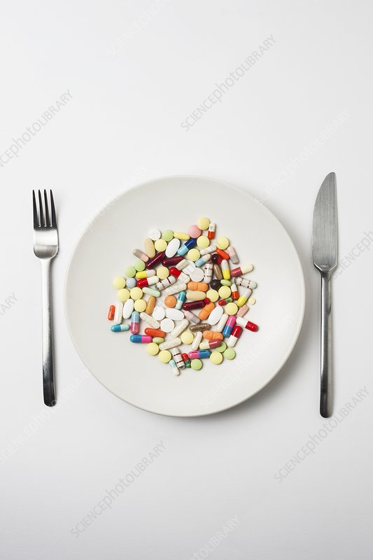 Plate with pills and cutlery
