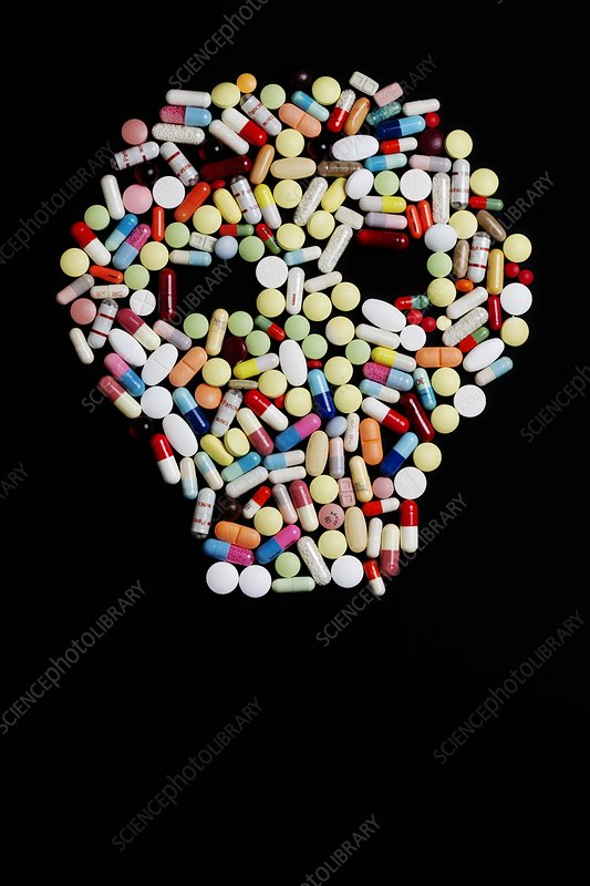 Pills and tablets in the shape of a skull