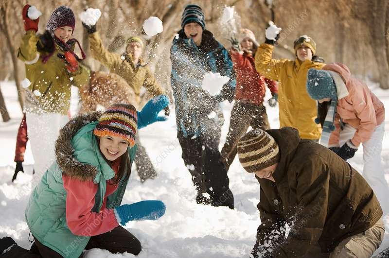 Boys and girls having a snowball fight