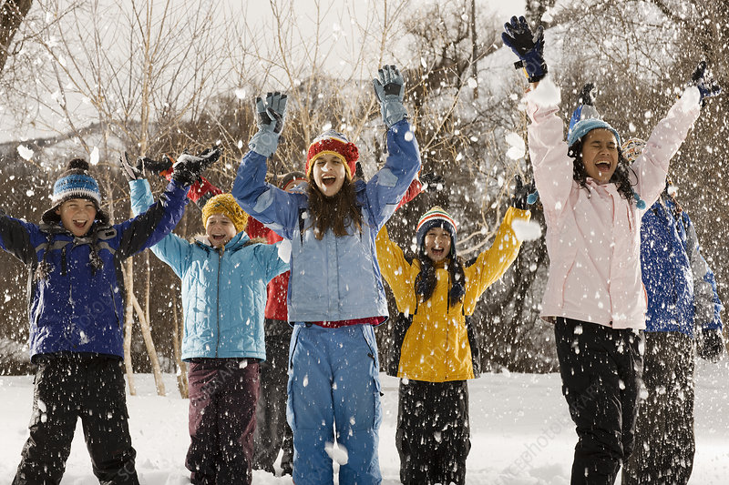 Young people laughing in falling snow