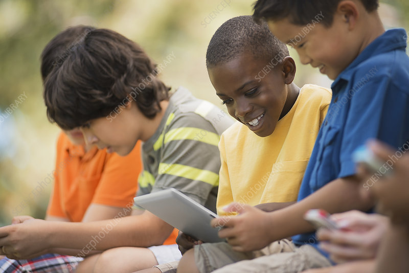 Children using digital tablets
