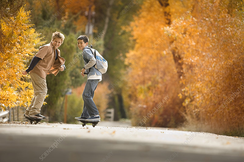 Two boys on skate boards