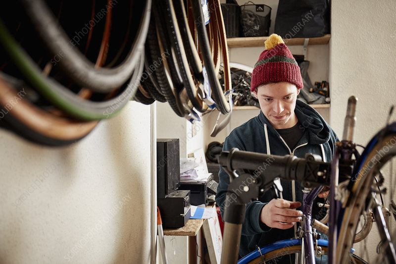 A young man working in a cycle shop