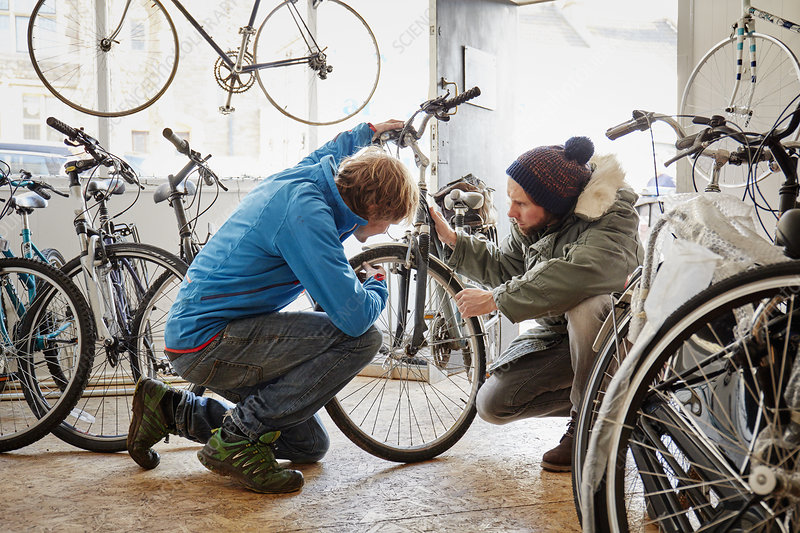 Two young men in a cycle shop talking