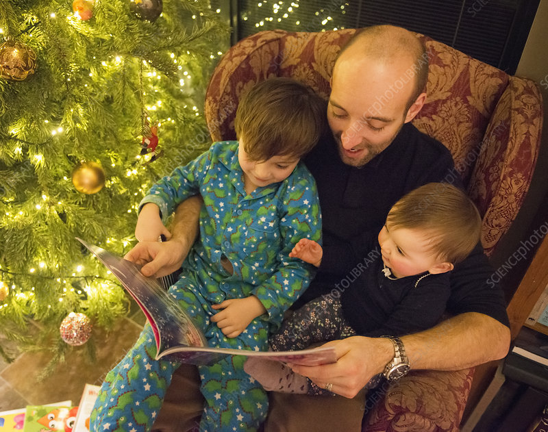 A man reading a story to his children
