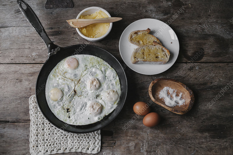 A dish of eggs bread and sauce