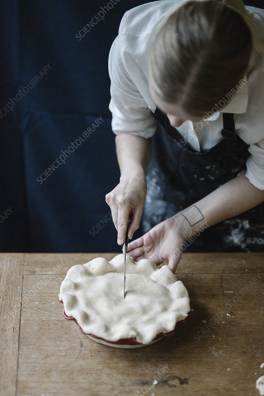 Cook crimping home pastry on a pie