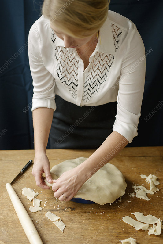 Crimping the pastry on a home made pie