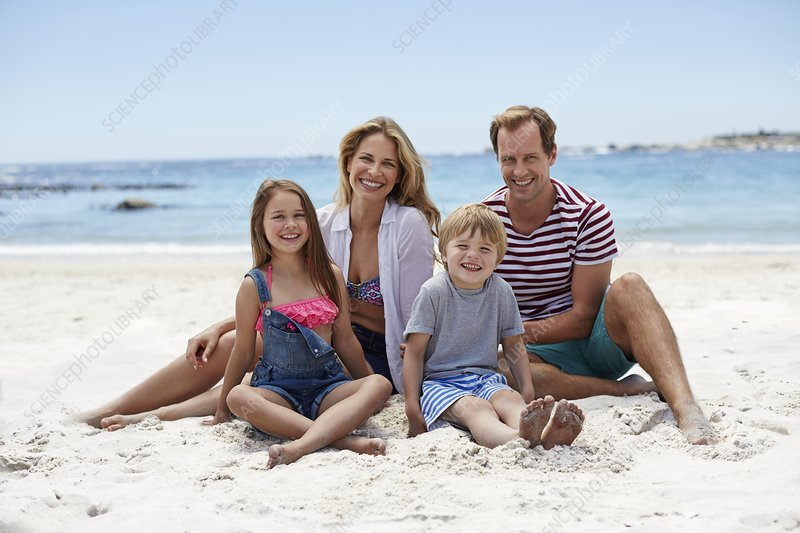 Family sitting on beach