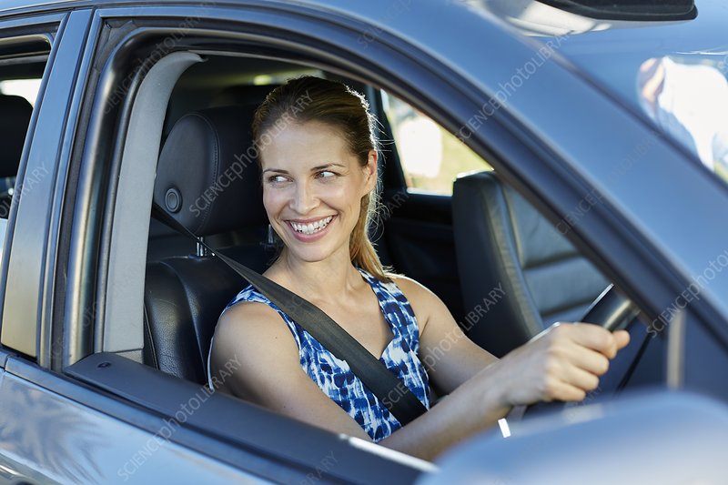 Woman looking through car window