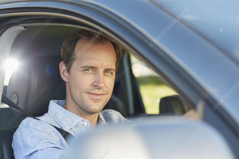 Mid adult man in car