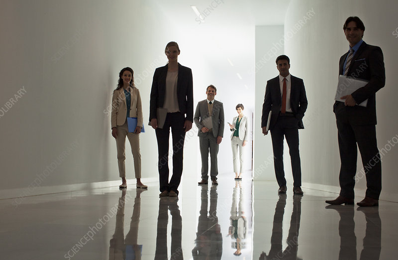 Portrait of business people in corridor
