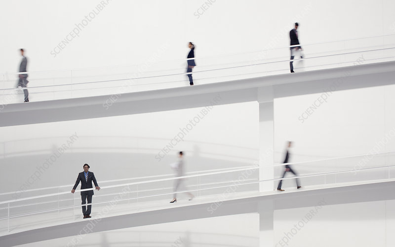 Blurred business people walking
