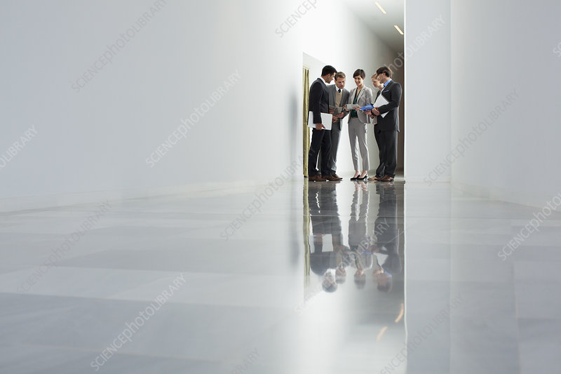 Business people meeting in corridor