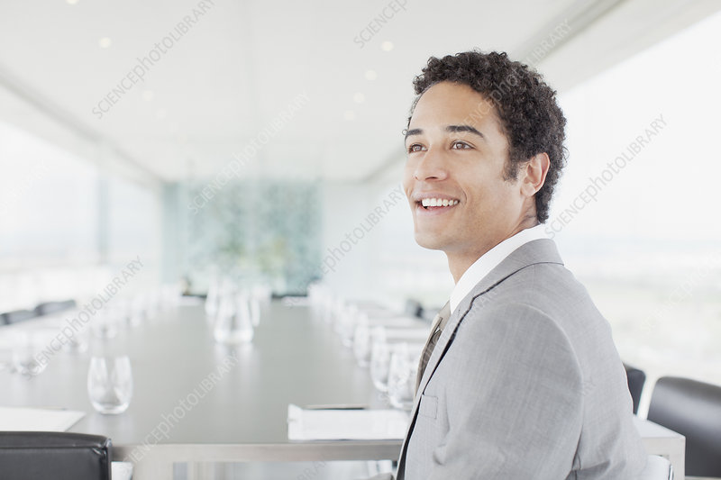 Smiling businessman in conference room