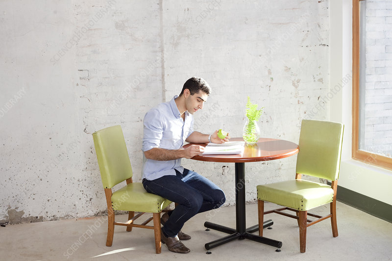 Businessman reading at table in office