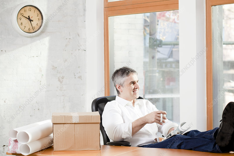 Businessman relaxing at desk in office