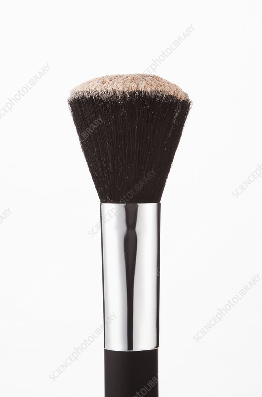 Close up of blush powder on makeup brush