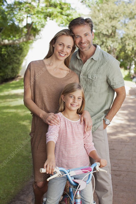 Portrait of smiling parents with daughter