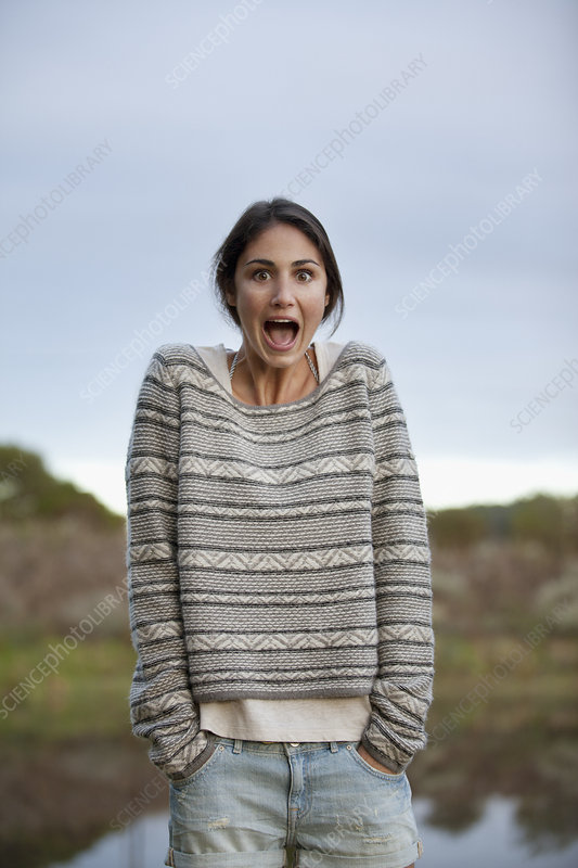 Portrait of surprised woman at lakeside