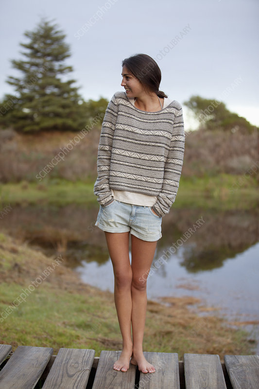 Smiling woman standing on dock