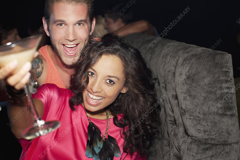 Couple drinking cocktail in nightclub