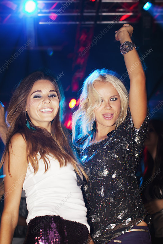 Smiling women dancing in nightclub