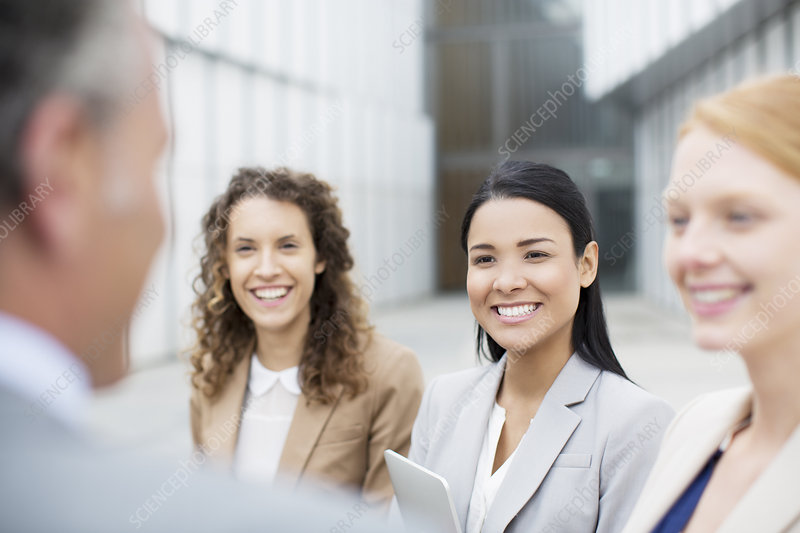 Smiling business people talking