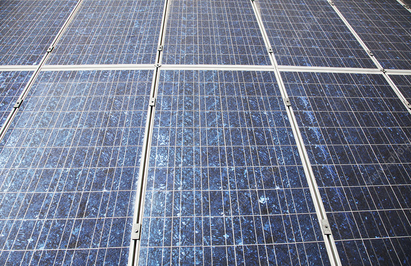 Sun shining on solar panels