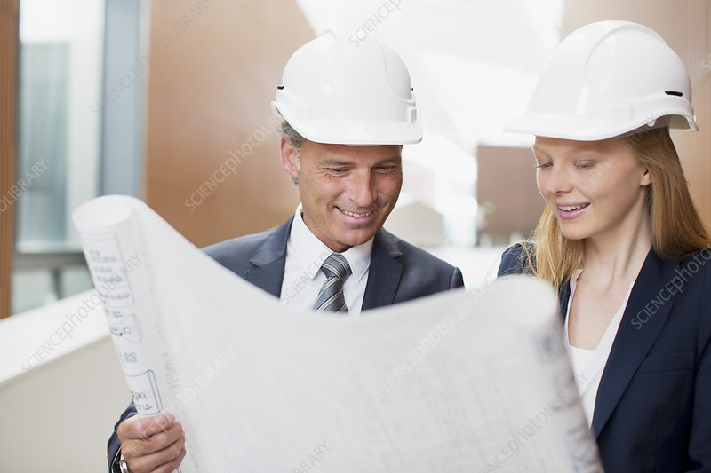 Architects wearing hard-hats