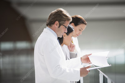 Doctors reviewing medical charts