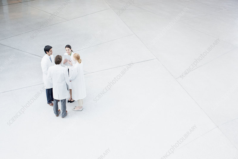Doctors talking in lobby