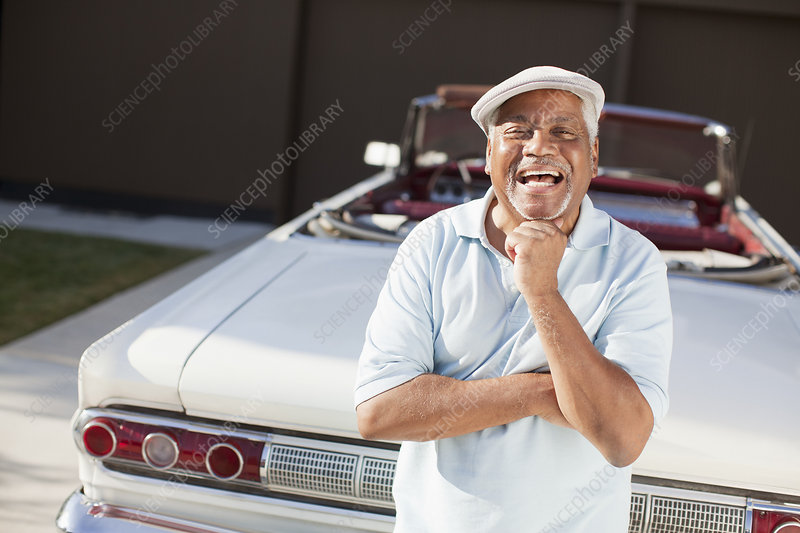 Older man smiling with convertible
