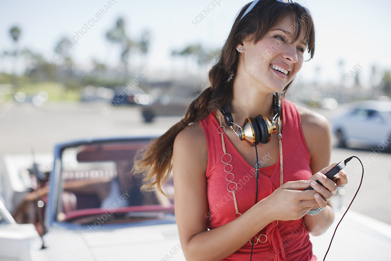 Smiling woman holding mp3 player
