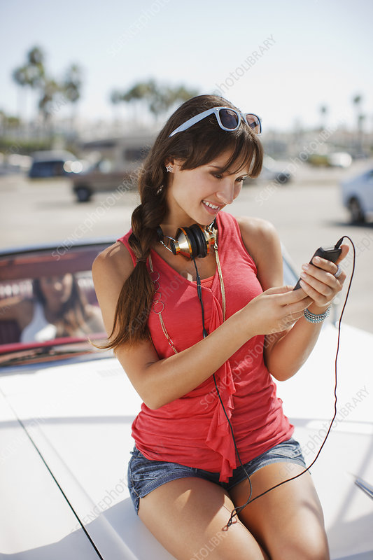 Woman listening to mp3 player on car