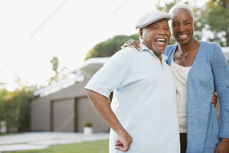 Older couple laughing together outdoors