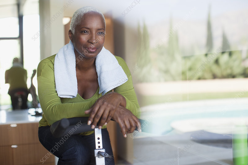 Older woman sitting on exercise bike